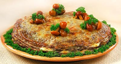 Pancake cake with mushrooms and smoked bacon