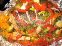 picture - Trout baked with lemon, pepper, greens, and Brussels sprouts