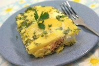 Salmon baked with eggs and potatoes