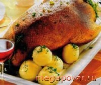 Goose, baked with apples and potatoes