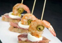 Canapes with ham, egg and shrimp