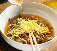 Korean soup with noodles and beef,