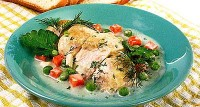 Chicken with vegetables in milk sauce