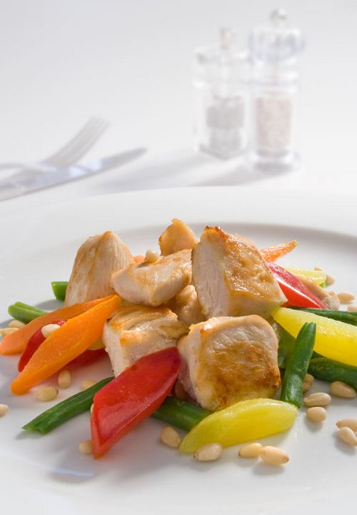 Chicken fillet with vegetables and pine nuts