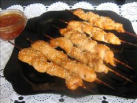 Chicken skewers marinated in marmalade