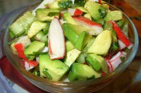 Light salad with cucumber, avocado and crab sticks