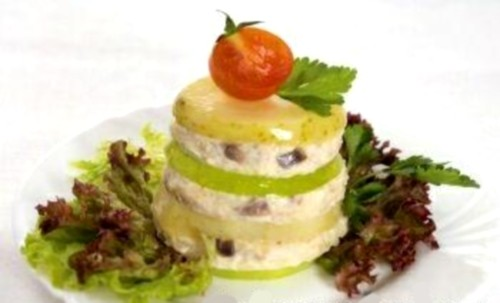 Christmas salad with minced herring of herring Tower