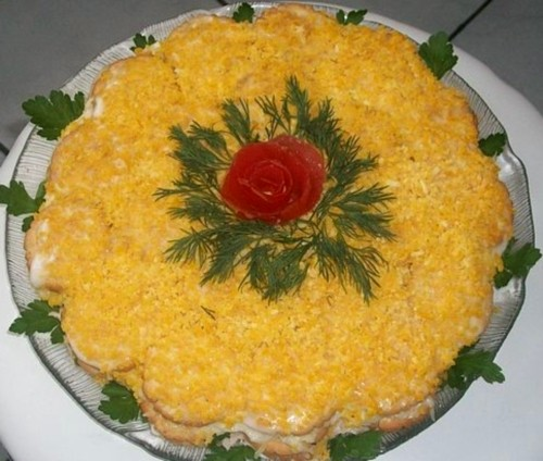 Christmas cake salad with crackers and fish