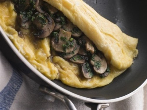 Scrambled eggs with mushrooms and tarragon