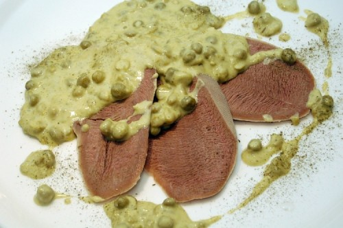 Boiled tongue with a sauce of peas