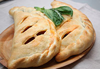 The pizza calzone with cabbage and oregano