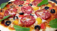Pizza with olives and salami