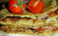 Pie on pita bread with mushrooms and vegetables