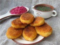 Pies potato with cheese and sour beetroot sauce