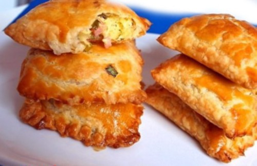 Pies with mushrooms, cheese and ham