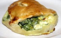 Pies with cheese and spinach puff
