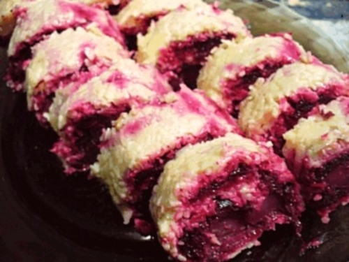 Roll with cheese, herring and beetroot