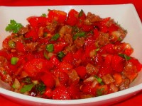 Salad of eggs and fish in tomato sauce