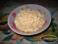 Salad of cod liver oil with egg and cheese