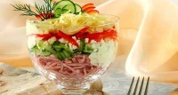 Salad-cocktail with cucumber, ham and cheese