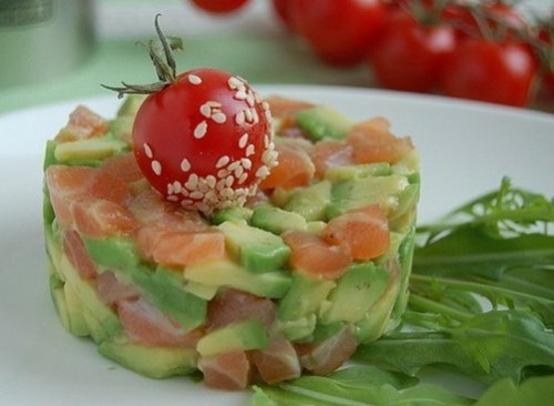 Salad with avocado, salmon, apple and nuts