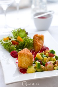 Salad with a hot soft cheese