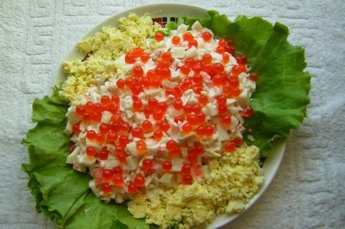 Salad with squid, crab sticks and red caviar