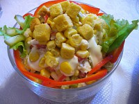 Salad with crab sticks, vegetables and crackers