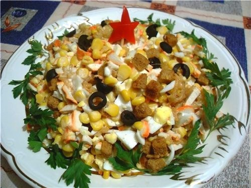 Salad with corn, sausage and crab sticks