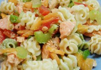 Pasta salad, vegetables and red fish