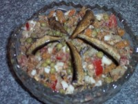 Salad with sprats and croutons