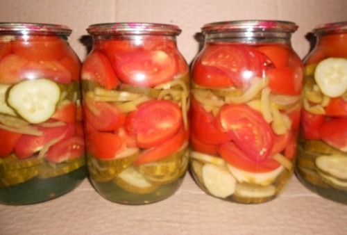 Salad with marinated harvesting tomatoes, cucumbers and onions