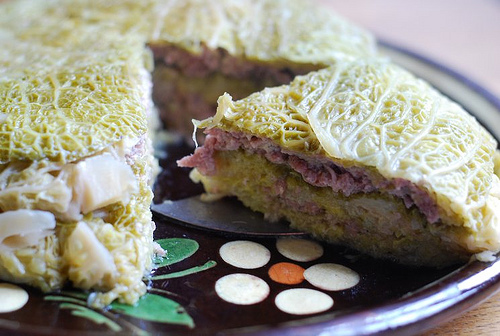 Puff pie with cabbage leaves