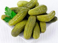 Sterilized pickled cucumbers with garlic