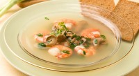Soup with shrimp and lemon