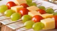 Cheese with tomatoes on skewers