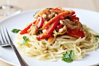Warm salad with chicken, vegetables and noodles