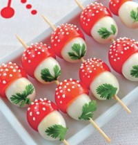 The festive appetizer of quail eggs and tomatoes