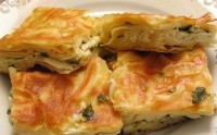 Snack puff pie with mushrooms and cheese