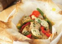 Baked chicken breast in an envelope with cheese and vegetables